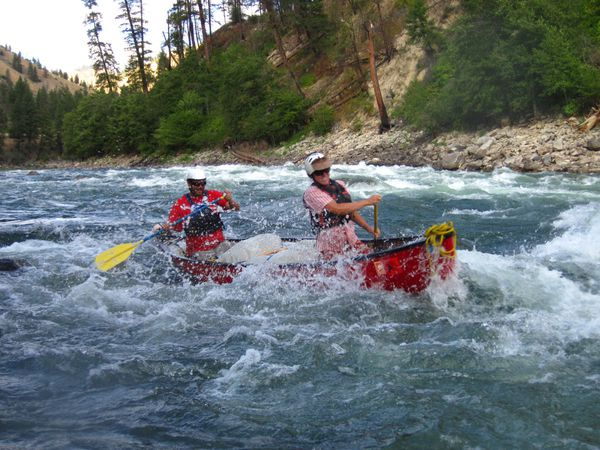 Course participants canoe through rapids on the Salmon River
